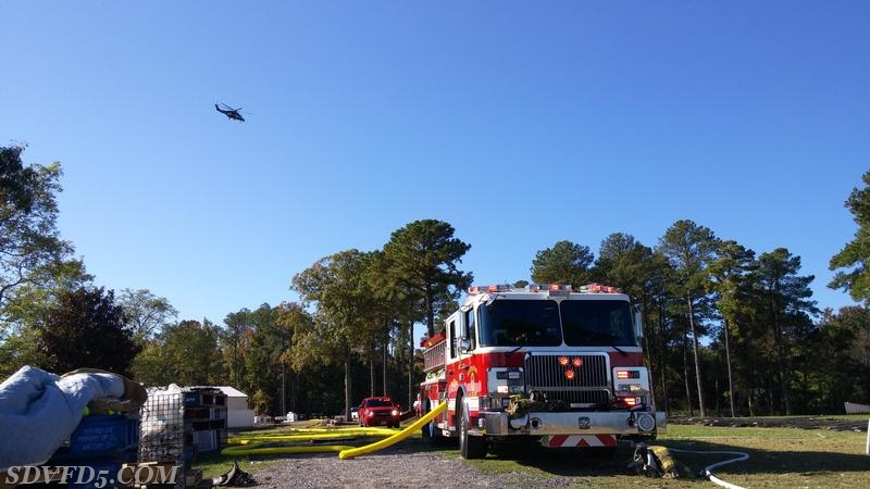 Engine 52 operating on scene with Trooper 7 above.