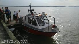 Boat 5 bringing patient to EMS on Boat accident in Bushwood